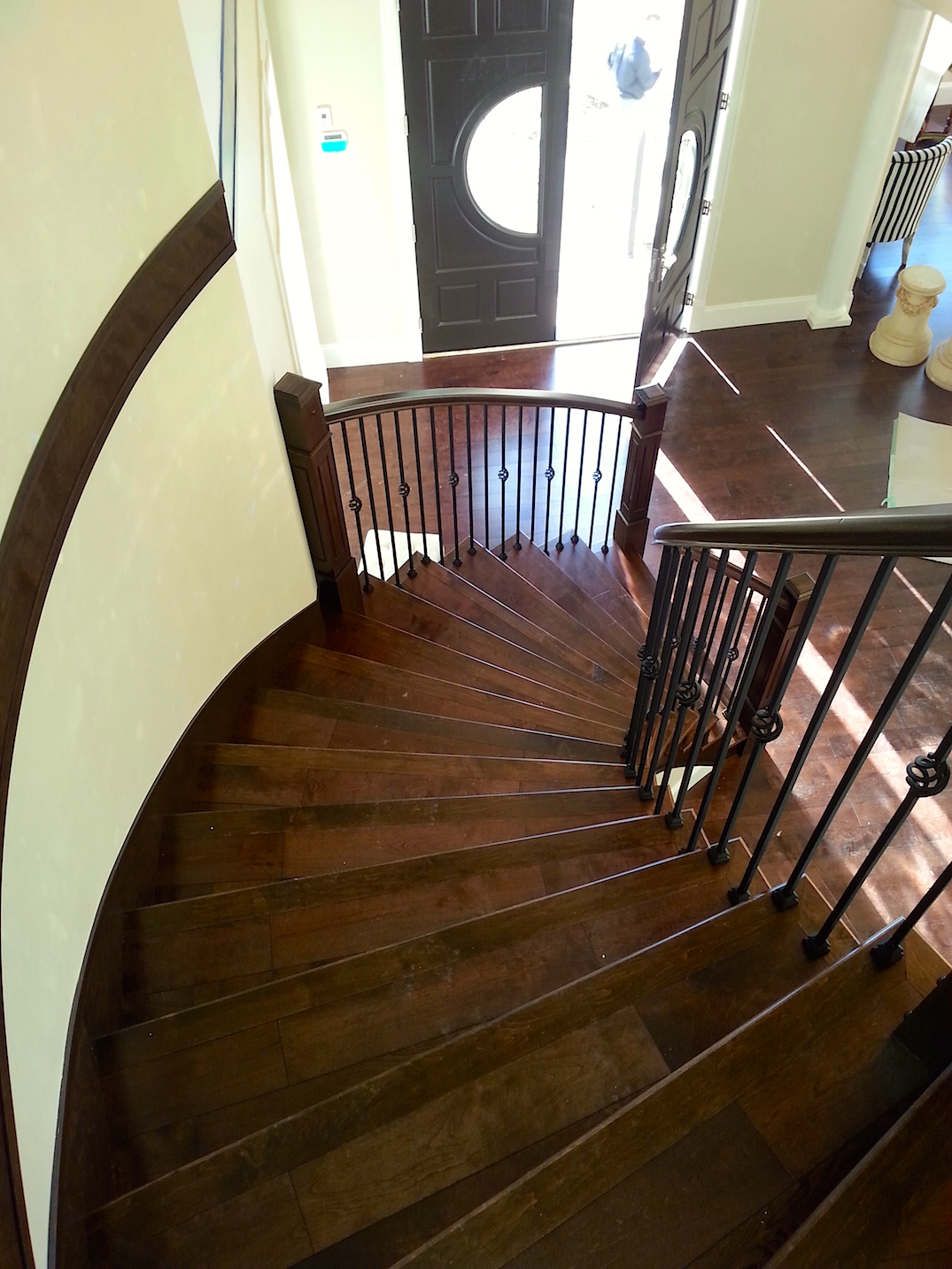 Curved hardwood stair isntallation
