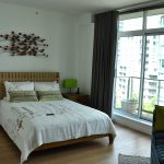 Modern bedroom with hardwood flooring