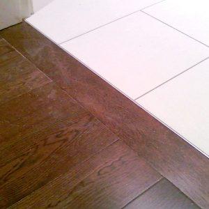 hardwood flooring connection to tile metal stripe